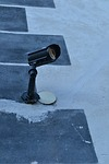 Surveillance camera alarm